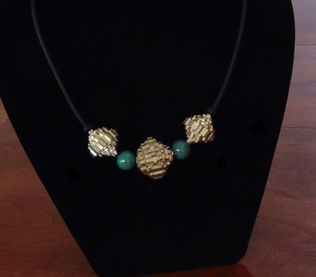 gold focal beads with handmade polymer clay spacers   $26USD